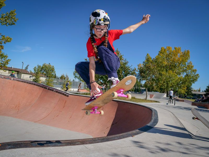 photo of girl getting air out of the skatepark